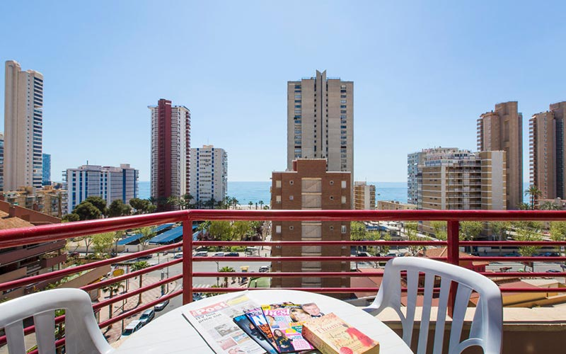 The balcony in Carlos V Apartments, looking out over some tall buildings in Benidorm