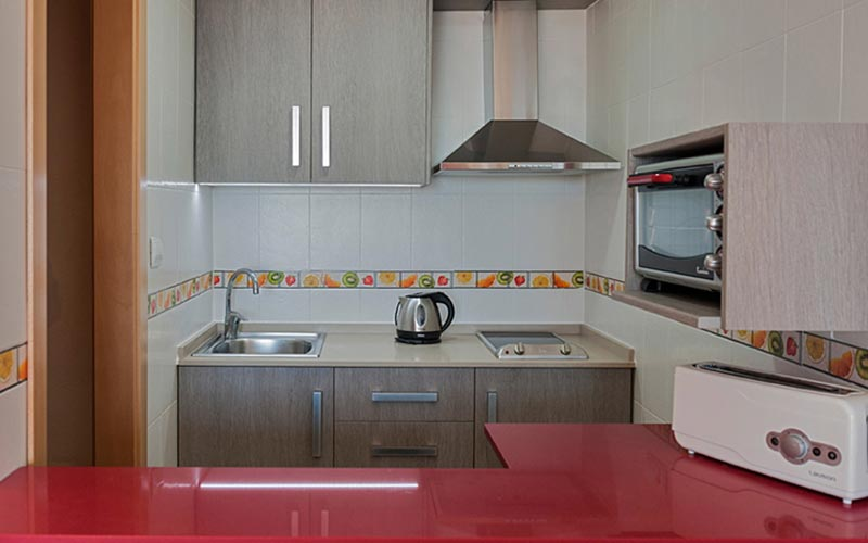 The kitchen area of La Era Park Apartments