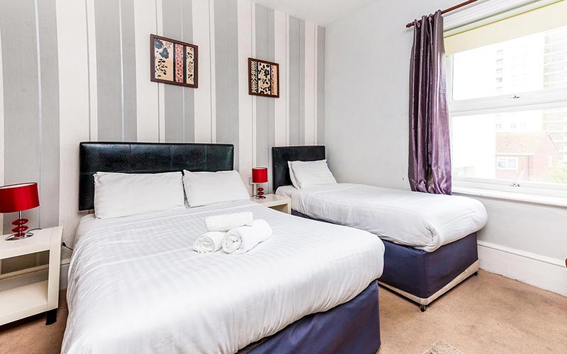 A double and single bed in a bedroom at The Westbourne Hotel, Brighton