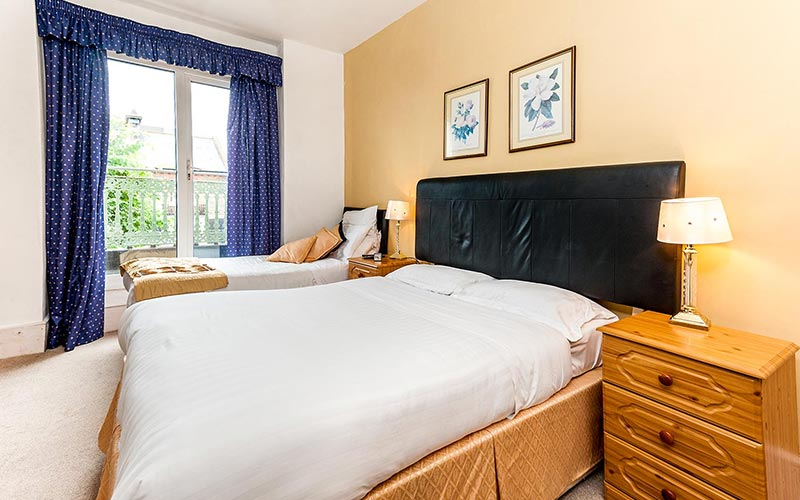 A double bed in a bedroom at The Westbourne Hotel, Brighton