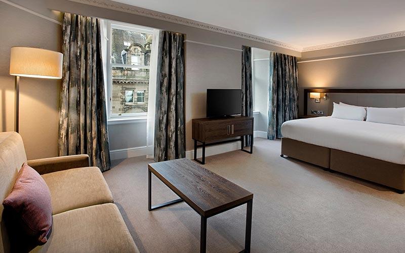 A bedroom suite at Hilton Edinburgh Carlton
