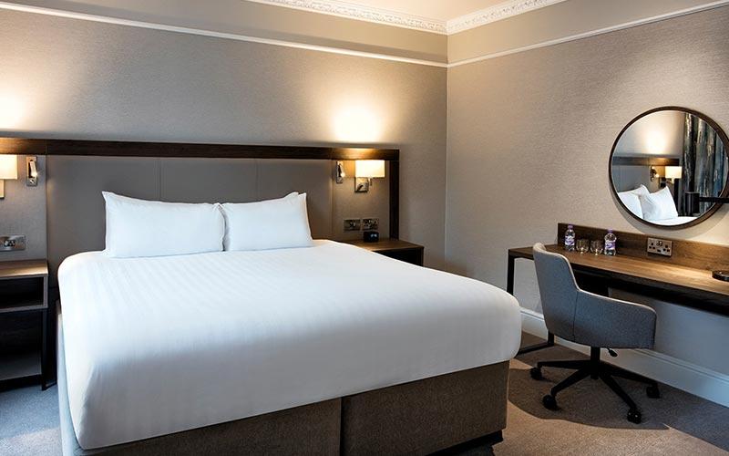 A double bed in a bedroom at Hilton Edinburgh Carlton