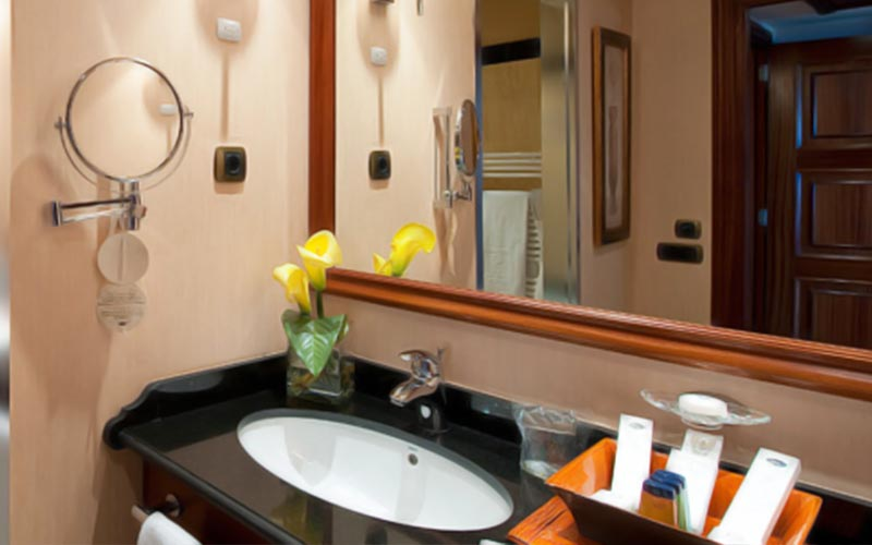 A sink in a bathroom in a room Elba Estepona Gran Hotel & Thalasso Spa
