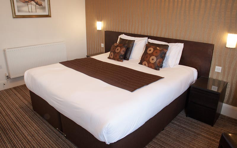 A double bed in a room at The Hop Inn, Bournemouth