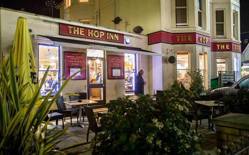 Exterior of The Hop Inn, at night