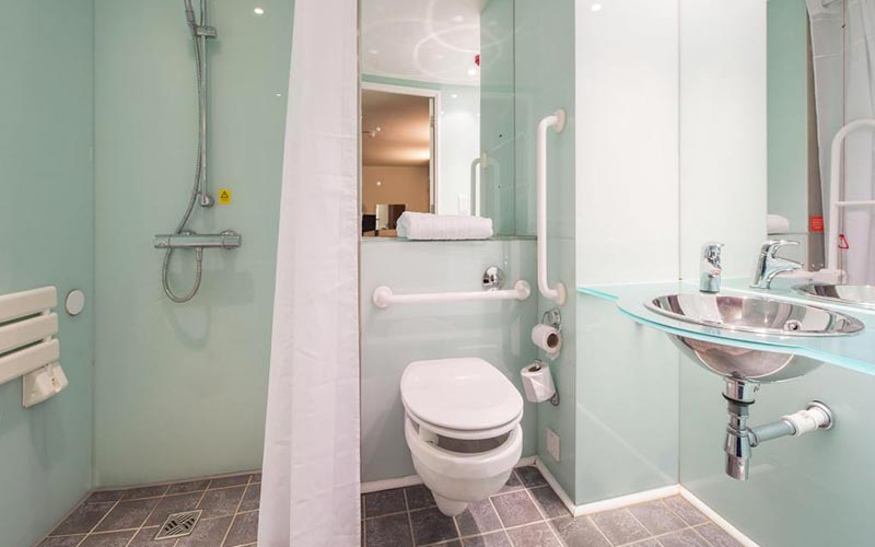 A duck egg coloured bathroom in Travelodge York Central Micklegate