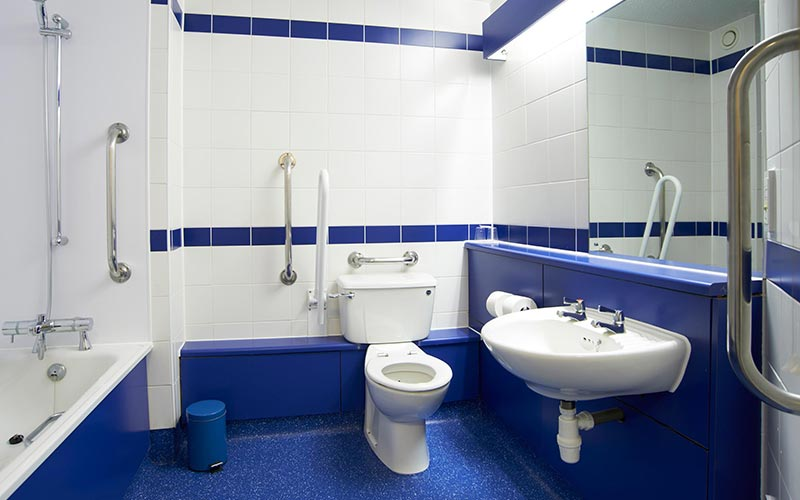 A bathroom in Travelodge Leeds Central with a blue and white colour scheme