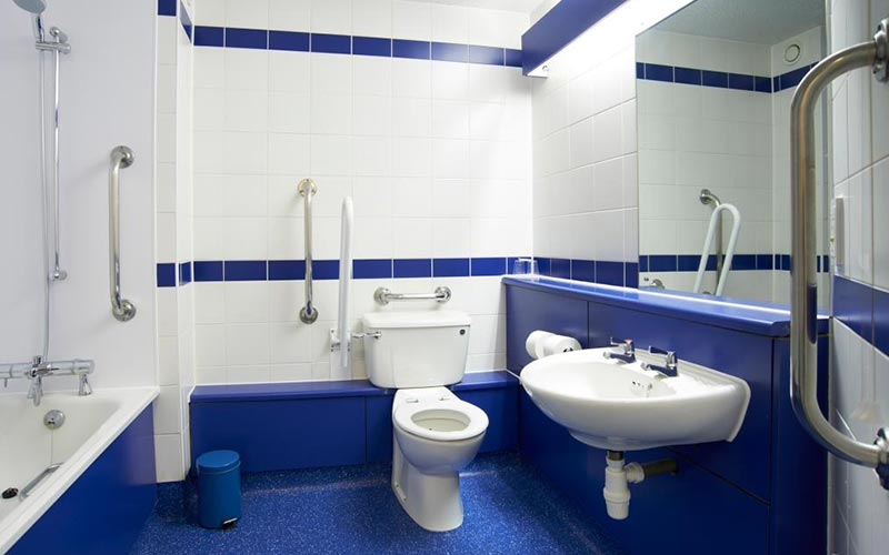 A blue and white themed bathroom in Travelodge Nottingham Central