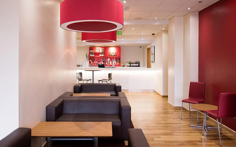 The bar area with comfortable seating in Travelodge Nottingham Central