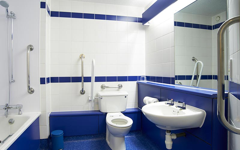 A blue and white bathroom in Travelodge Southampton