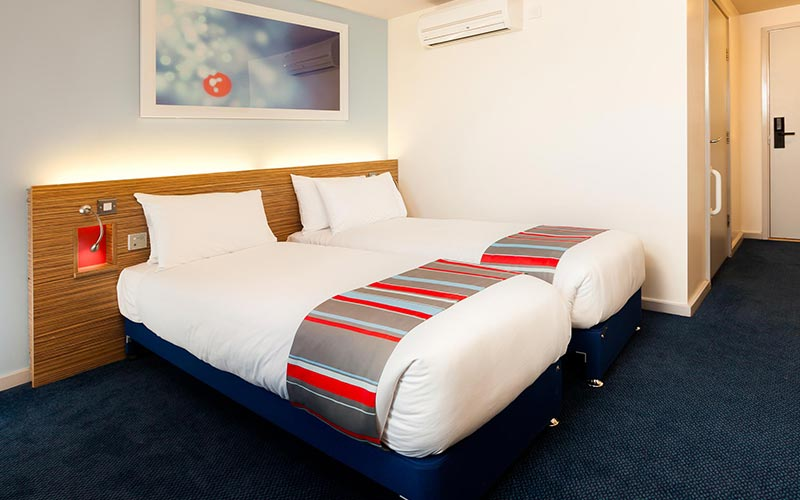 Two single beds in a room in Travelodge