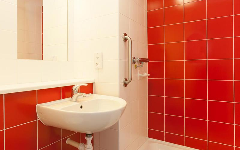 A red and white bathroom