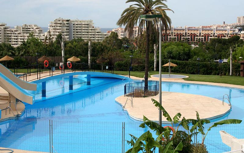 Outdoor pool at Apartmentos Minerva Jupiter