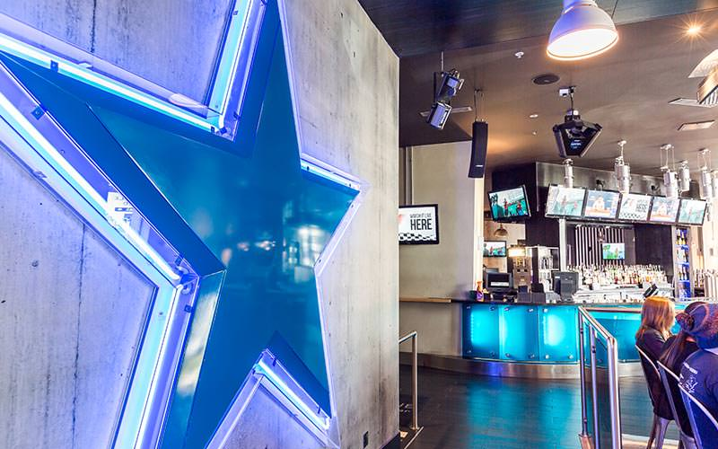 The bar area in Signature Sandman with a blue star on the wall
