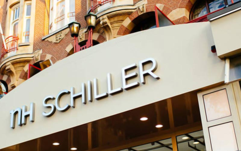 The exterior of NH Schiller and the signage above the door