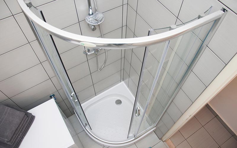 A white tiled shower area