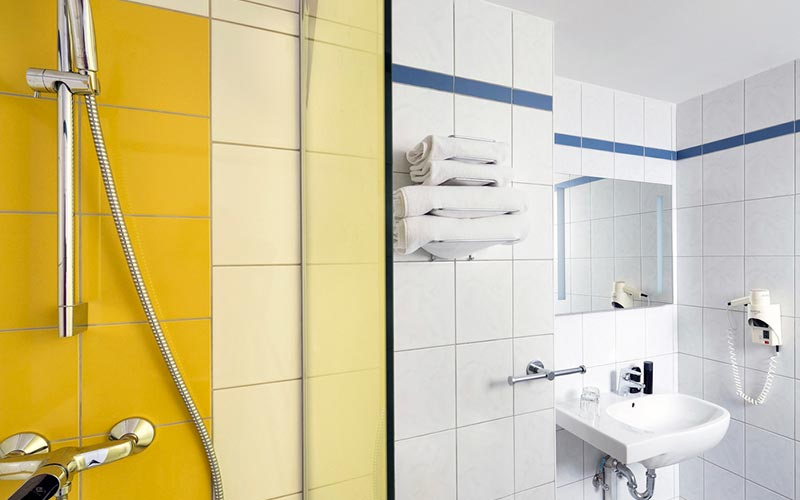 A lemon yellow, blue and white bathroom