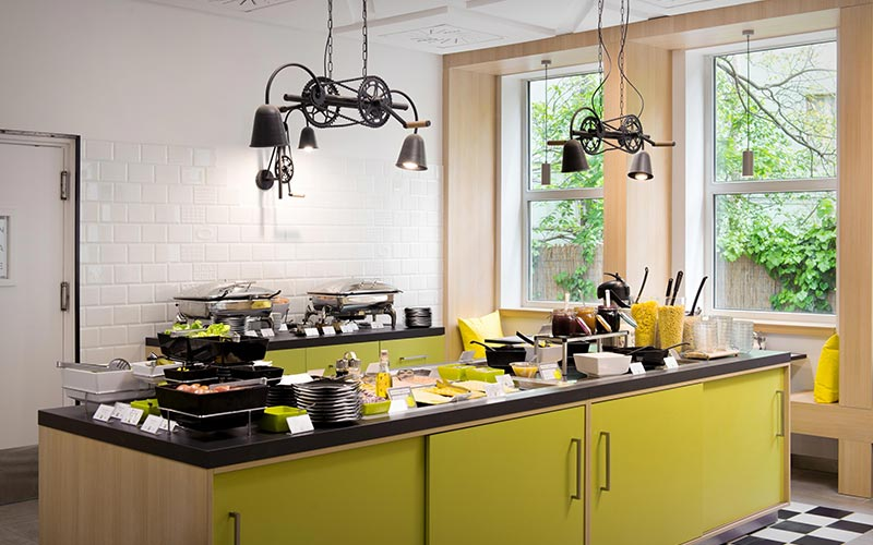 A lime green, black and white kitchen area