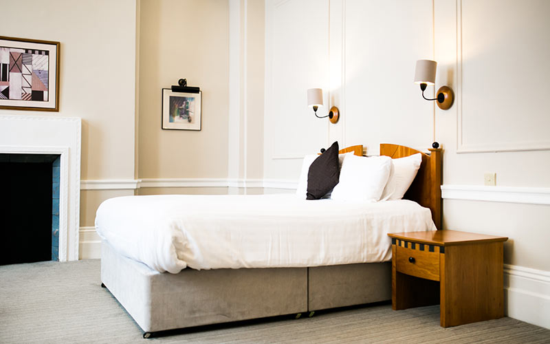 An opulent double bedroom in The Angel Hotel