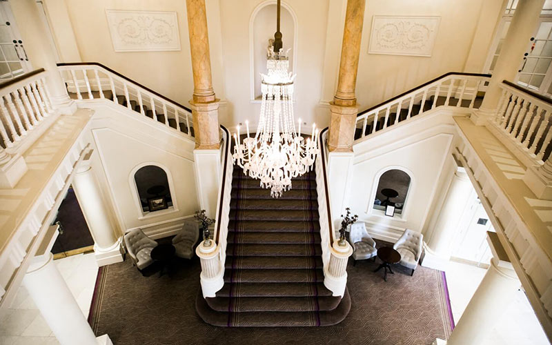 A glamorous staircase in The Angel Hotel