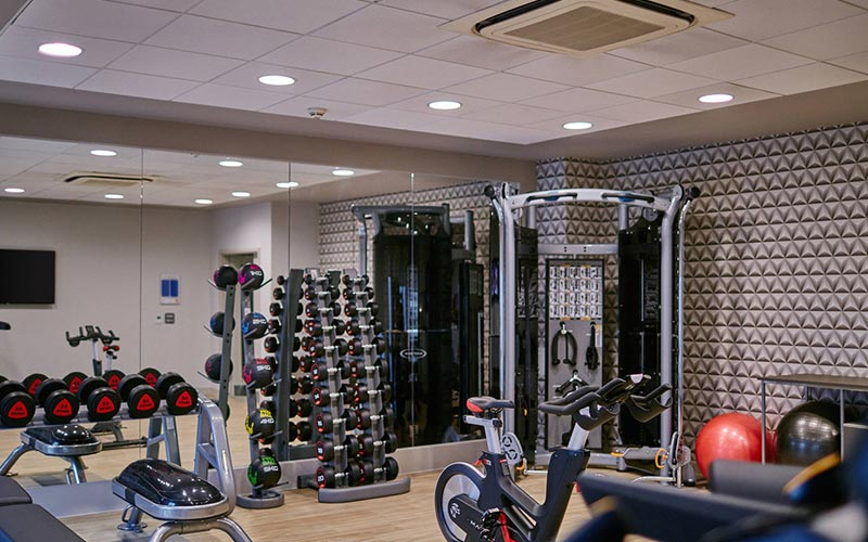 A room filled with gym equipment