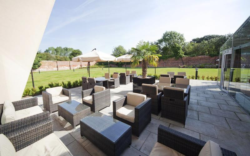An outside seating area at DoubleTree Hilton