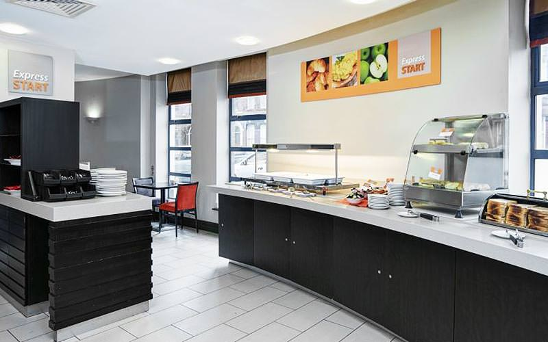 Monochrome breakfast counters with food on top at the Holiday Inn Express Queen
