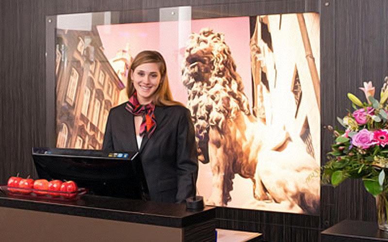 A receptionist behind a desk