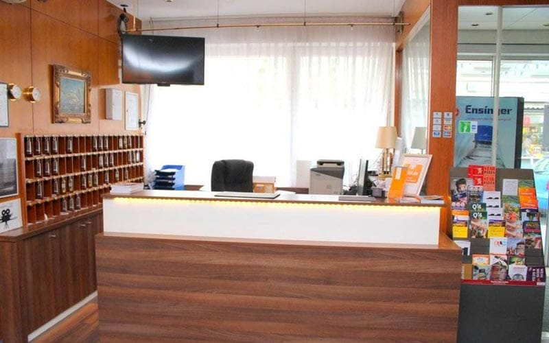 Wooden reception desk with leaflet stand