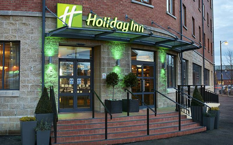 The exterior Holiday Inn Belfast City Centre sign and entrance