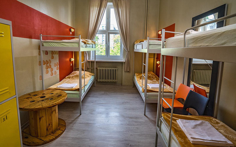 A room with a number of bunk beds in