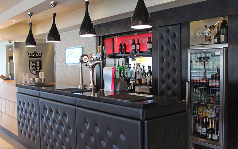 The black, plush leather bar area