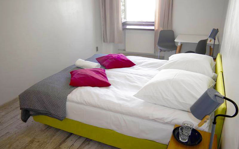 A double bed in a light room