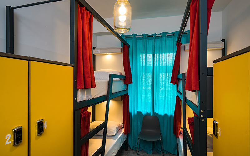 A room with bunk beds and lockers