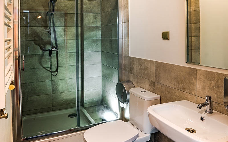 A bathroom with a shower, toilet and sink