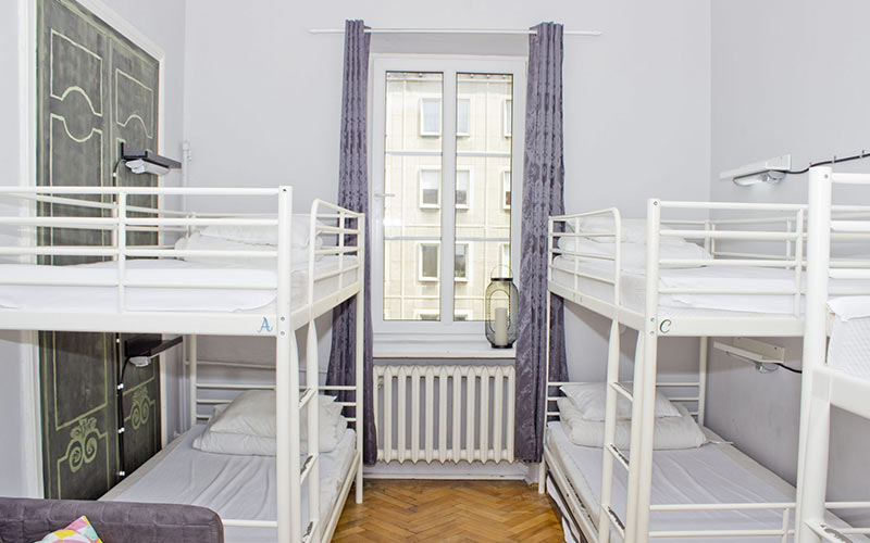 A neutral room with white bunk beds