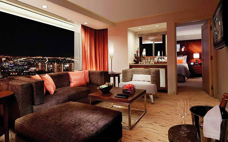 The lounge area of a suite at ARIA resort with views over Las Vegas at night