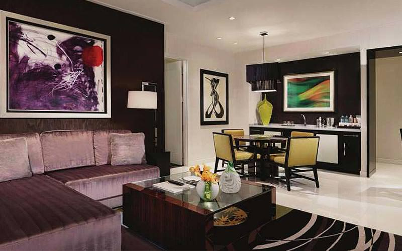 The lounge and bar area of a large suite at ARIA resort
