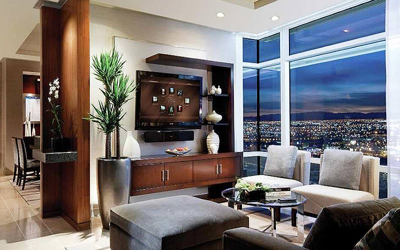 The lounge area of a large suite at ARIA resort with views over Las Vegas at night