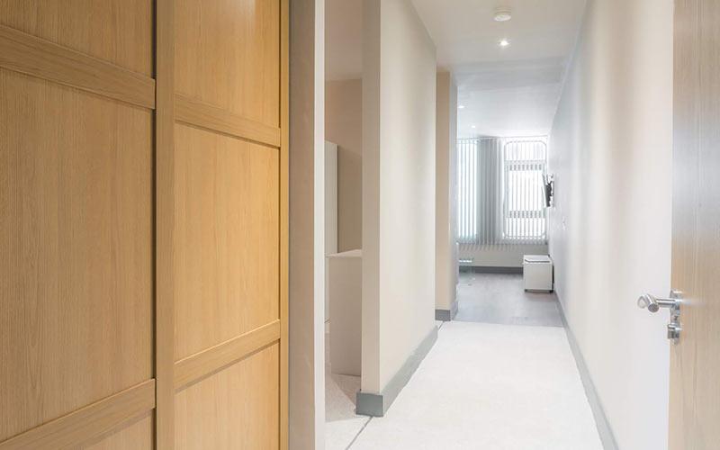 A long corridor leading into a room