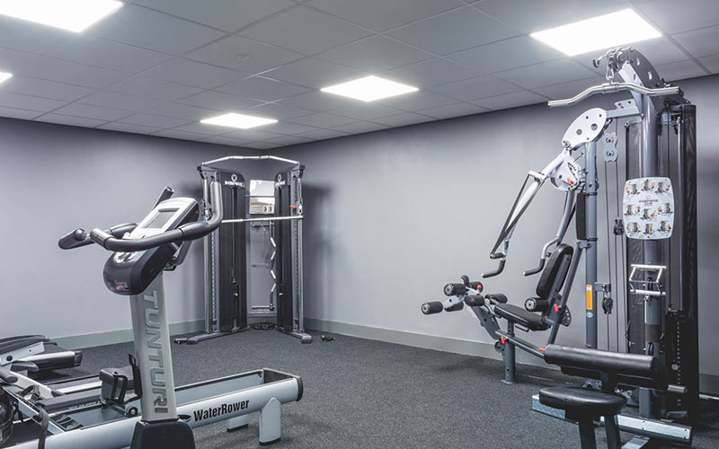 A room with gym equipment in