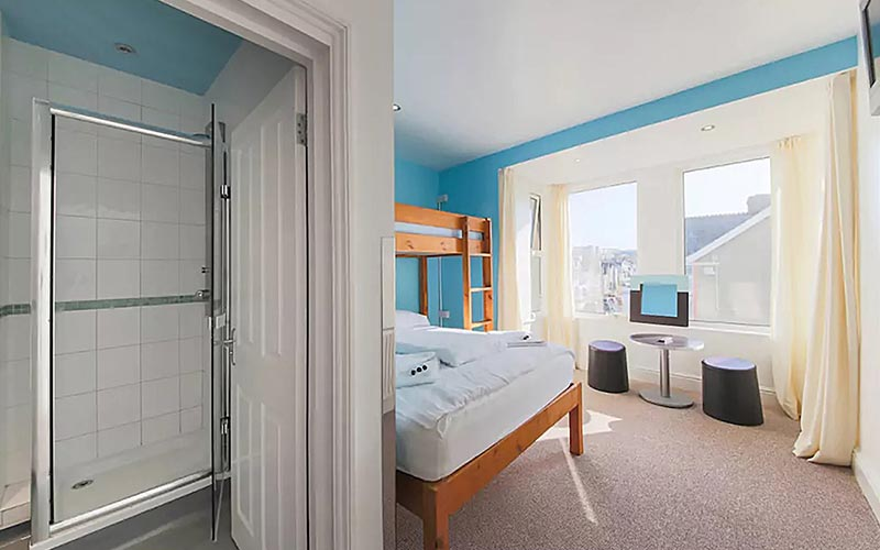 A guest bedroom at Blue Reef with a view of the bathroom