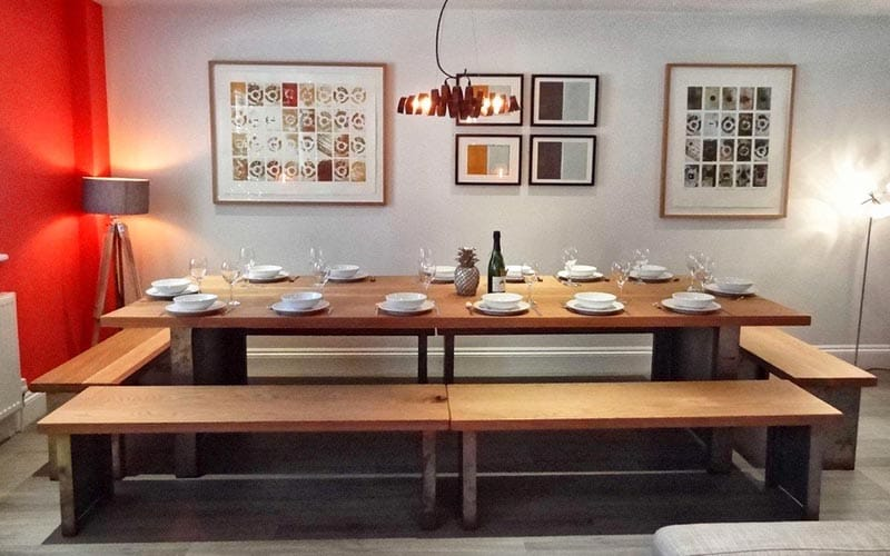 A large dining room area set for a big dinner party