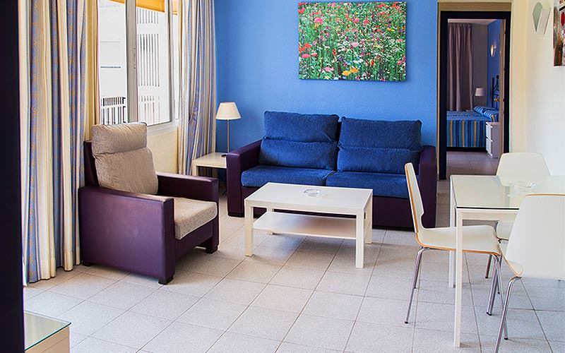 A colourful seating area in an Ecuador Apartments apartment