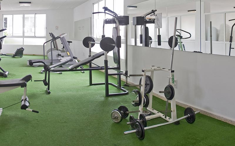 A room with gym equipment inside