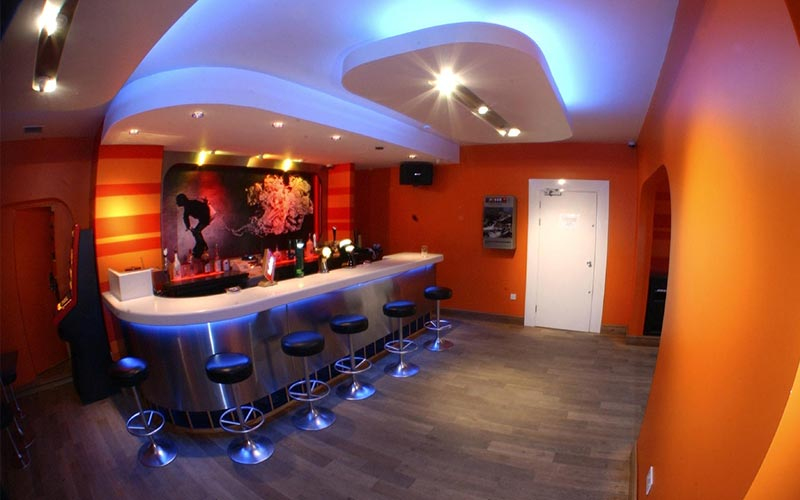 A bar area with orange walls