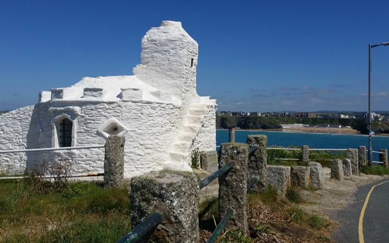 White ruins of a building on the coast of Newquay during the day
