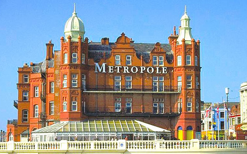 The exterior of The Metropole Hotel during the day