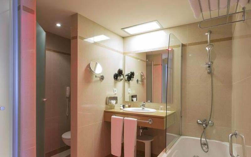 A large bathroom with shower and sink