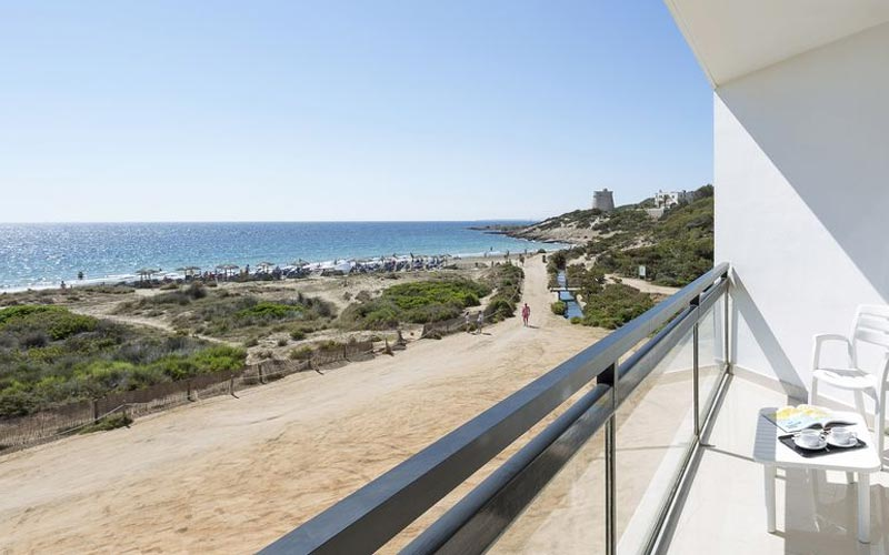 A balcony with a view of the beach